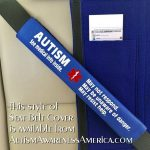 Seat belt cover reads Autism so emergency personnel will understand passenger or driver is Autistic.