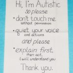 Personal sign reads: Hi, I'm Autistic with instructions.